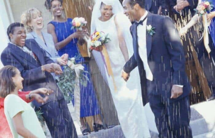 rice being thrown at a wedding